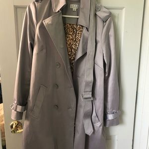 Joan rivers silver trench jacket with belt.